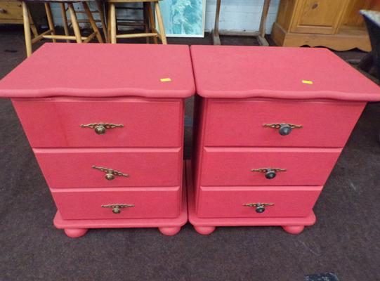 Pair of red solid wood bedside cabinets, good contrast against white background