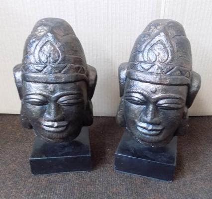 Pair of contemporary Budha heads on stands