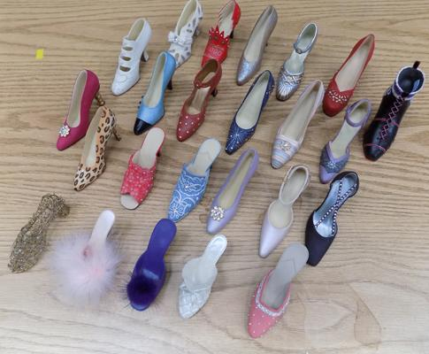 Collection of 'Just the right shoe' and other ceramic shoes