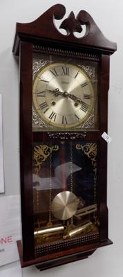 Highlands wall clock, decorated with nouveau white metal corners. With key and pendulum