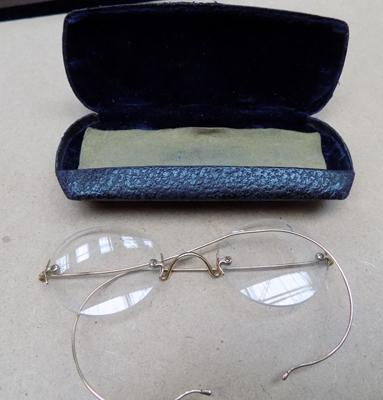 Pair of antique yellow metal spectacles in original pouch