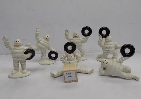 Six small Michelin men with tyres