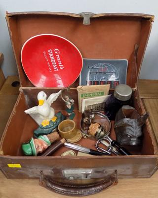 Small vintage suitcase with key containing collectables