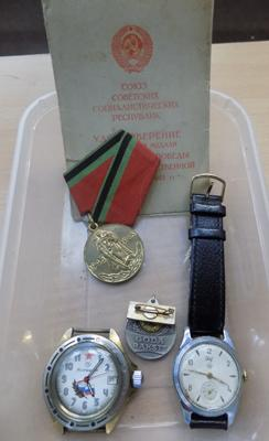 VOSTOKE and SVET Russian vintage watches and 1965 WWII victory medal with certificate and service badge