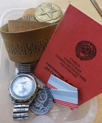 Russian VOSTOK military watch, Russian military belt with buckle and 1981 work sense medal with paperwork