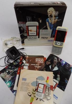 Nokia phone in box with accessories