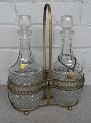 Cut glass tantalus in metal stand with stoppers