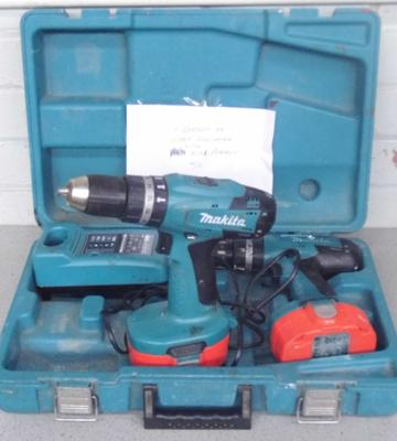 Two Makita cordless drills, with charger - one battery OK, one weak