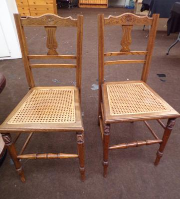 Pair of carved back rattan chairs