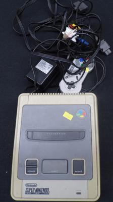 Super Nintendo Entertainment System with all cables