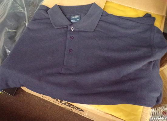 Box of Uneek polo work shirts - various sizes