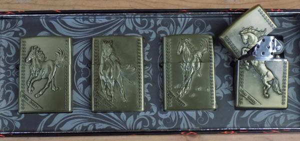 Set of 4 new oil lighters with horse design in box