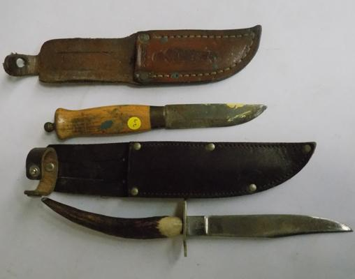Two vintage knives in sheaths