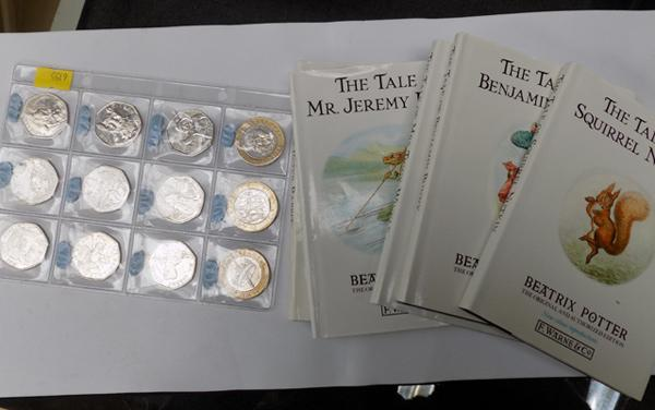 Selection of 50p & £2 coins + Beatrix Potter books