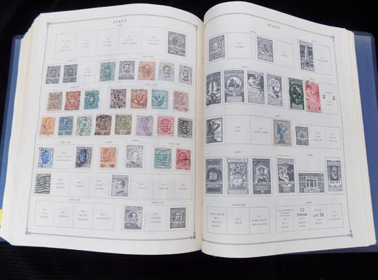 Large printed 'International' stamp album-sparsely filled