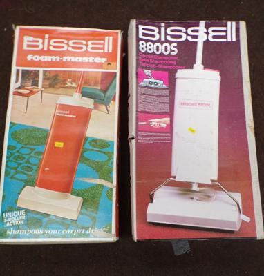 Two Bissels manual carpet cleaners