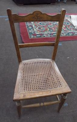 Vintage rattan chair with slight damage