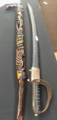 Dress sword and carved walking stick