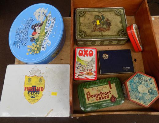 Box of assorted tins in wooden drawer