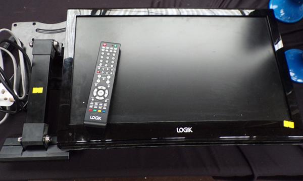 "Logix 21"" flat screen TV with DVD wall plate and remote"