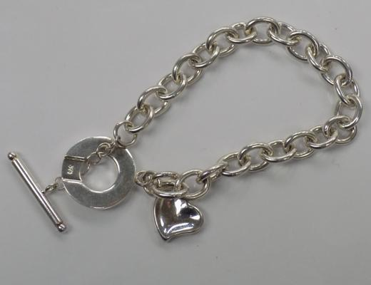 Silver charm bracelet with Links of London charm