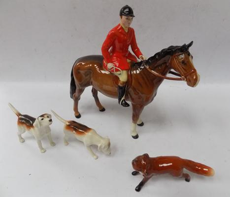 Beswick Hutsman Brown, issued 1957-1995 with fox issued 1956-1997 and two hounds issued 1941-1969