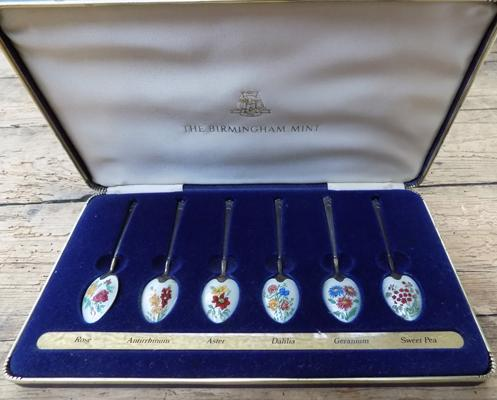 Vintage cased enamelled spoon set, silver with gold gilded
