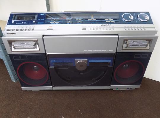 "Sharp, both sides Play Disc stereo system VZ-2000 in excellent condition size 28"" x 22"" x 8"" in W/O"
