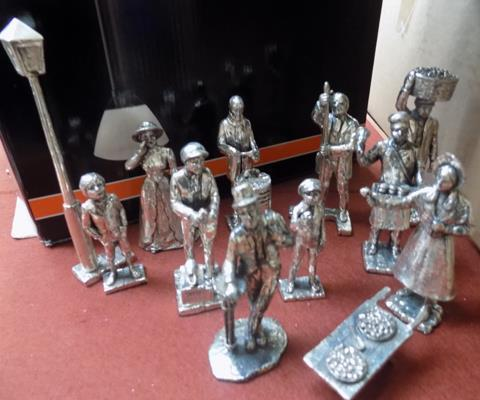 Selection of pewter/silver plate street vendors