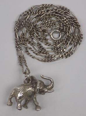 Silver Figaro chain with heavy silver elephant pendant