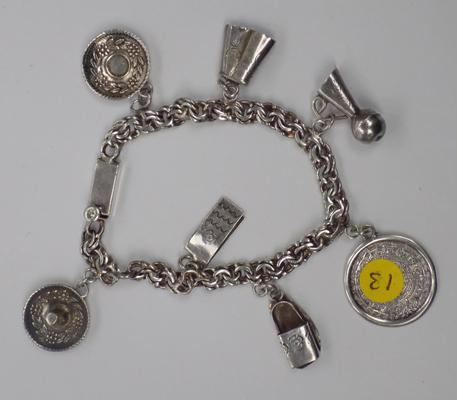 Unusual Mexican silver charm bracelet