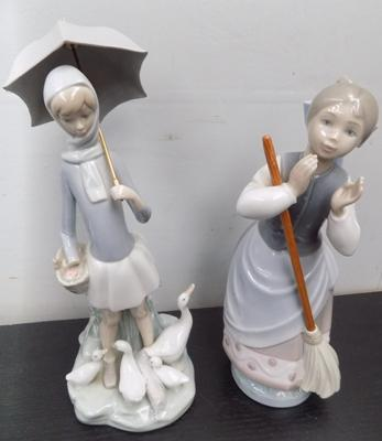 Two Lladro girls, one with broom, one with umbrella - damage to one girl, hand broken off but incl. with item