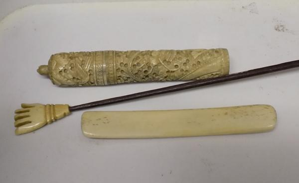 Selection of bone items, incl. page turner, back scratcher & cane top
