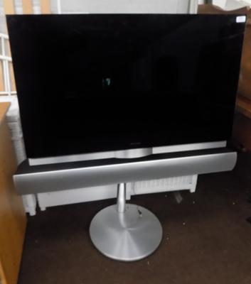Bang and Olufsen Tv on stand with sound bar