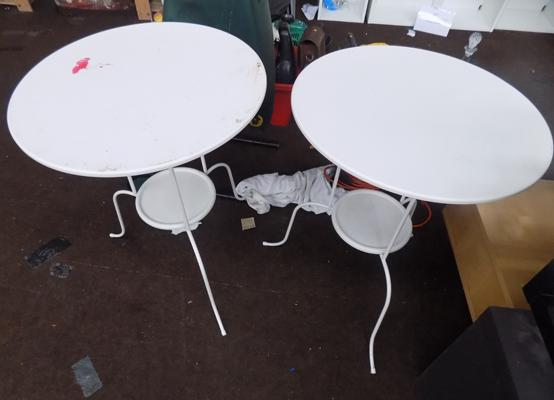 2 round metal tables