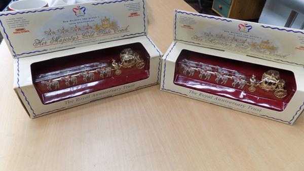 2 x boxed Her Majesty's gold plated carriage by Matchbox, very good condition