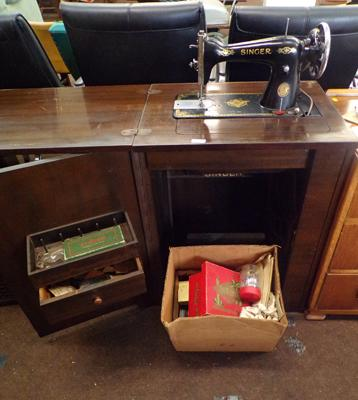 Vintage Singer sewing machine with treadle & cabinet