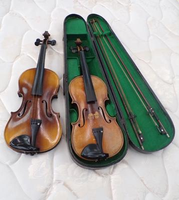 Two vintage violins with case + two bows