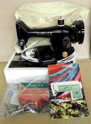 Singer sewing machine and attachments