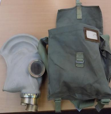 Polish gas mask in bag with tables