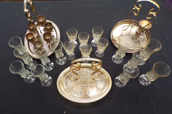 3 serving trays and glasses