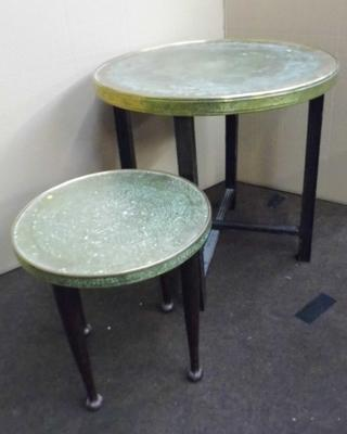 Pair of brass topped relief decorated occasional tables