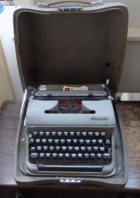 Vintage Olympia typewriter in case