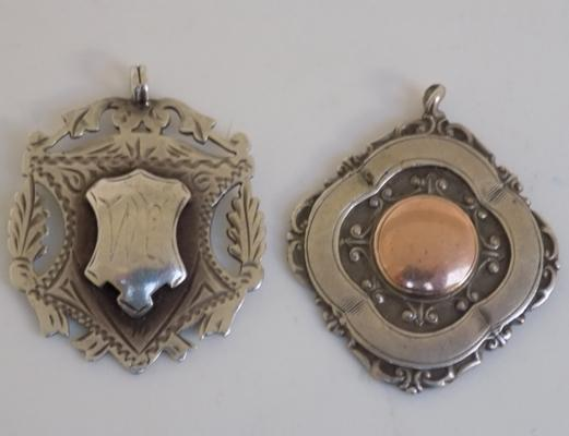 Pair of silver fobs, one with rose gold inlay