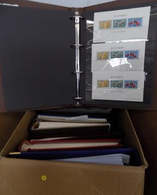 Box containing 11 stamp albums