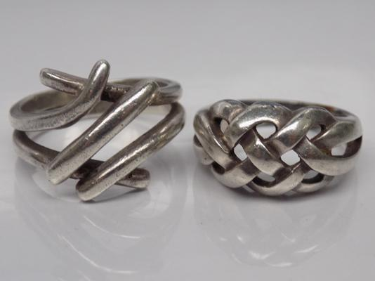 Two heavy silver modernist rings