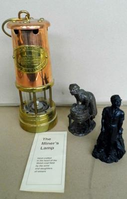 Miners lamp and other figures