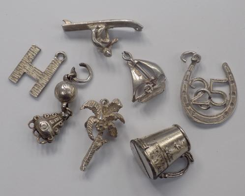 Six silver charms & one other (tankard)