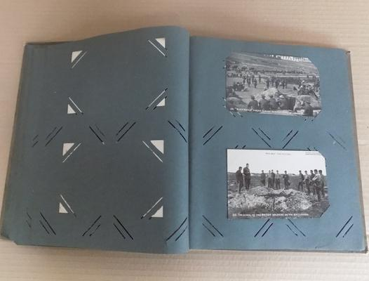 Postcard album with military postcards