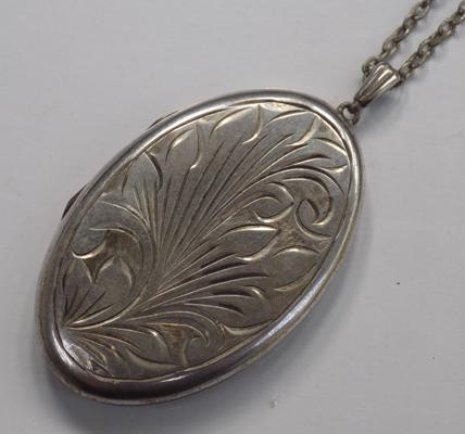 Solid silver locket on silver chain